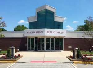 Photo of the library's facade, linking to a video tour of library services.